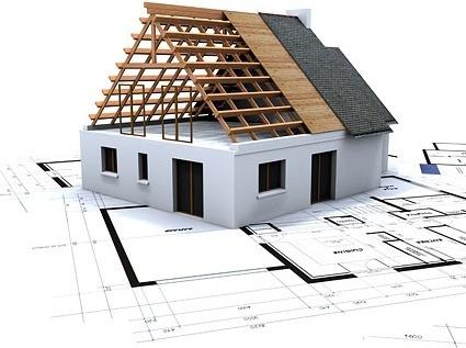 Husmodell står på ritning av hus.